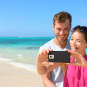 Smartphone – beach vacation couple taking selfie