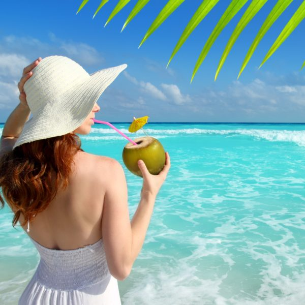 coconut fresh cocktail profile beach woman drinking tropical Caribbean